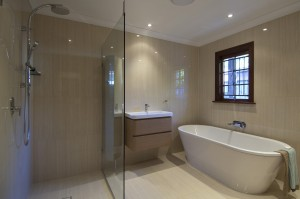 Timber window frame in bathroom, free standing bath, wall mounted bath spout