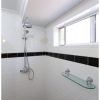 Double shower Cashmere main bathroom, traditional glass shower shelf, tile into window