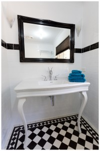 Black and white floor tiling swan vanity spout white traditional console
