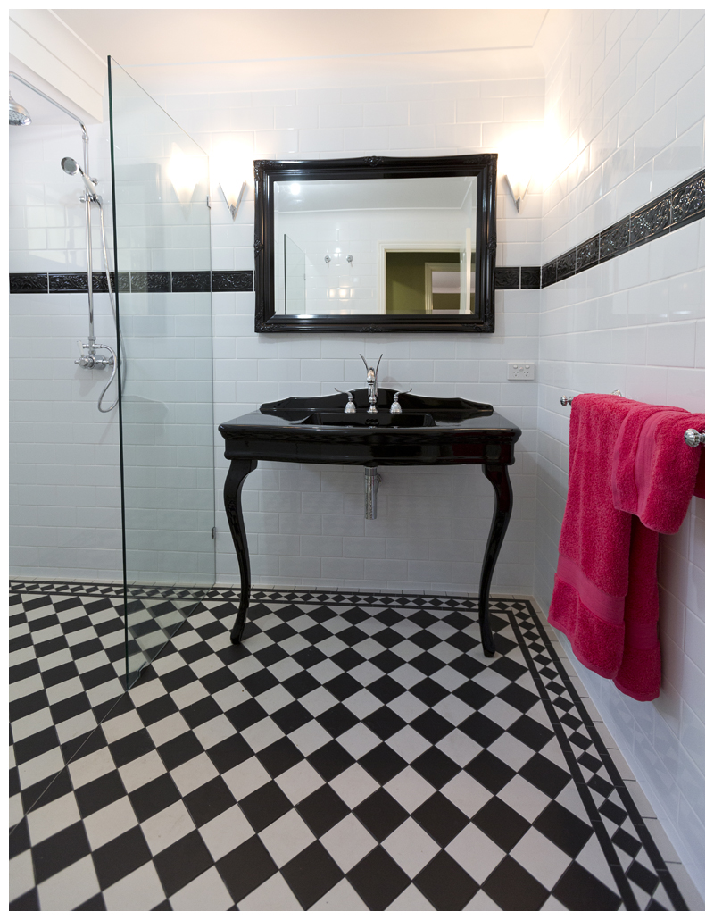 Black console black frame mirror horizonal subway tiles with feature