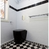 Cashmere ensuite subway wall tiles black feature tile in wall cistern toilet suite