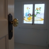 Close up traditional door handle stained glass window