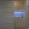 LED strip lighting in concealed laundry