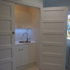 Concealed laundry cabinetry mosaic hexagon floor tiles