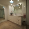 Vanity and linen cupboard, full length mirror, glass panel shower screen