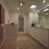 Bathroom wide angle - nib wall to conceal toilet suite, full-length mirror, custom vanity and linen cupboard