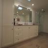 Linen, vanity, glass panel shower screen
