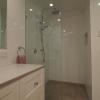 Twin shower on rail, glass panel shower screen
