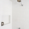 Gooseneck-shower-head-recessed-wall-niche-beveled-edge-subway-tiles