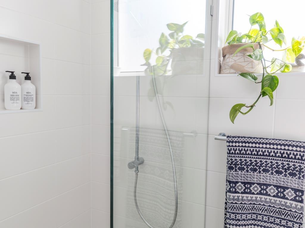 Brisbane bathrooms open shower niche window glass screen hand shower