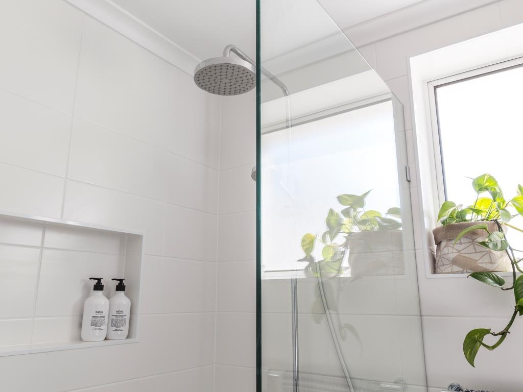 Brisbane bathrooms rain shower glass panel screen window white wall tiles
