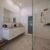 Ascot bathroom ensuite Carrara marble herringbone wall hung vanity subway tiles cavity slider landscape