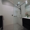 2 Wide angle small bathroom renovation black tapware fittings subway tiles glass panel
