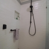 3 Portrait shower bathroom renovation black tapware subway wall tiles