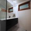 4 Wide angle small bathroom renovation timber window wall hung black vanity subway tiles