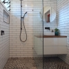 Portrait shower screen white subway wall tiles black pattern hexagon floor timber vanity