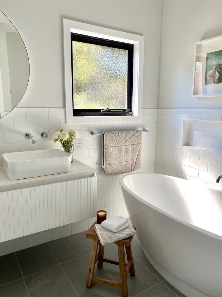 Bardon bathroom custom vanity free-standing bath circle mirror white wall tiles grey floor tiles