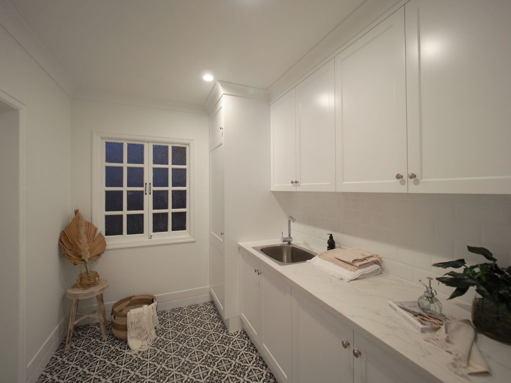 ascot laundry black and white floor tiles white cabinets laundry tub