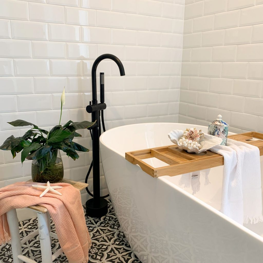 ascot main bathroom free standing bath white wall tiles black and white floor tiles black tapware