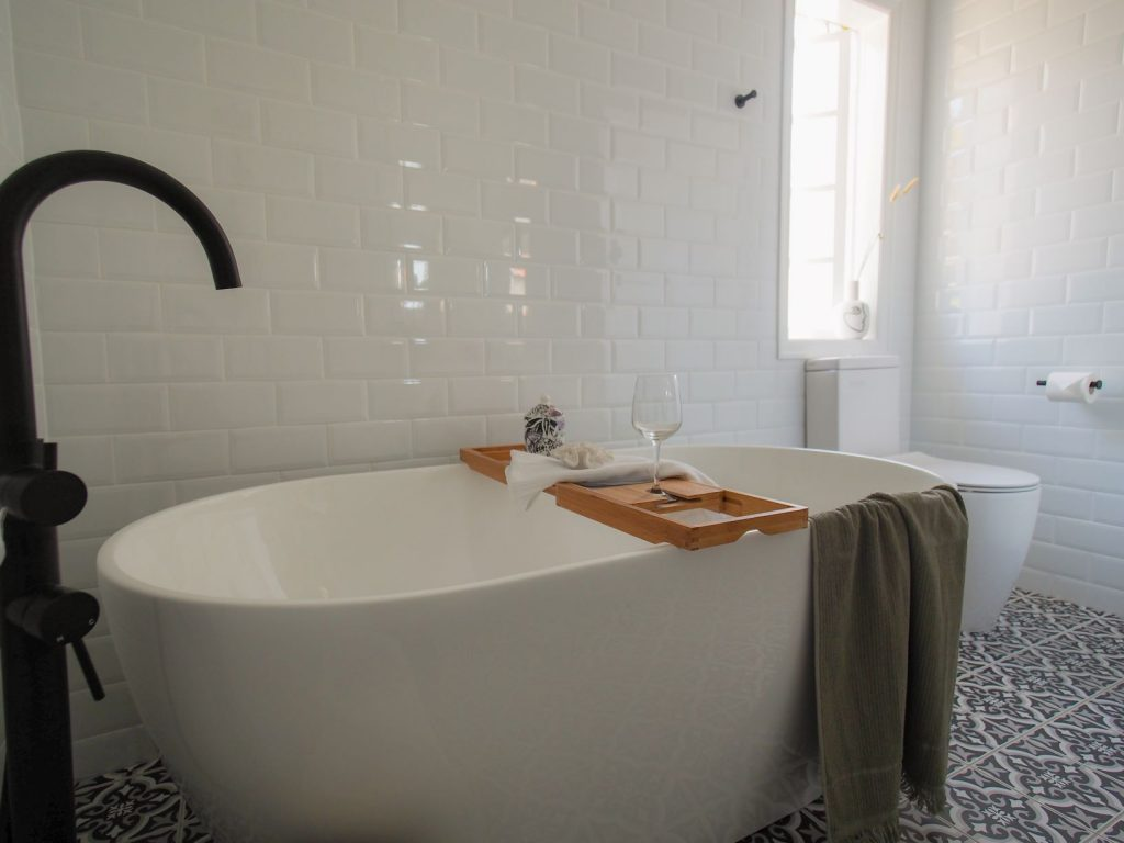 ascot main bathroom free standing bath black and white floor tiles white wall tiles toilet suite back tapware