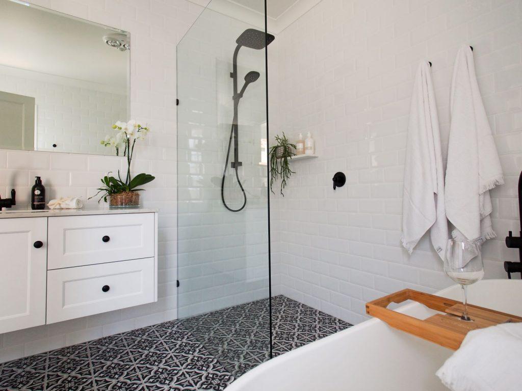 ascot main bathroom black and white floor tiles shower screen rain shower vanity free standing bath white wall tiles