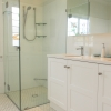 clayfield_bathroom_hexagonaltiles_showerscreen_vanity_mirrorcabinet_medium